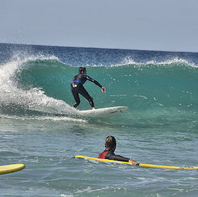 Young boy surfing in Fuerteventura